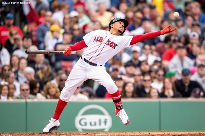 BOSTON, MA - APRIL 15: Mookie Betts #50 of the Boston Red Sox catches a pitch that skipped off the dirt while batting during the sixth inning of a game against the Tampa Bay Rays on April 15, 2017 at Fenway Park in Boston, Massachusetts. (Photo by Billie Weiss/Boston Red Sox/Getty Images) *** Local Caption *** Mookie Betts